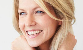 Learn about Botox Cosmetic link, showing a beautiful smiling blonde woman happy with her smooth complexion.